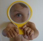 Boy with a yellow magnifying glass trim