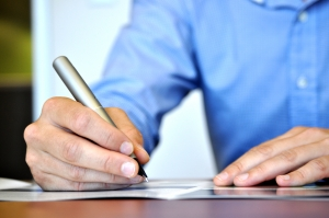business man writing The Importance of Brand Storytelling in 2013 and Beyond